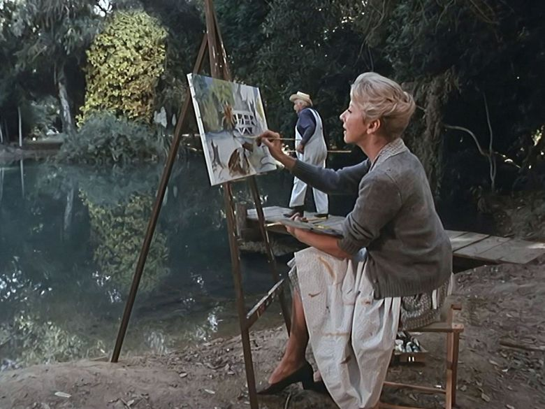 Olivia painting a picture of Drucilla's Pond